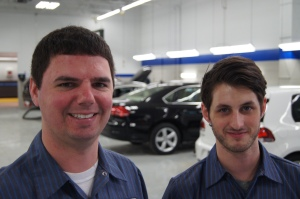 Veteran VW Master Technician Alex Klun works with technician Preston Frantz, who has experience with Lexus.