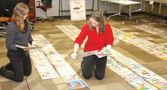 Judges from Motors Management chose winners from more than 330 holiday coloring contest entries submitted to Luther Auto stores.