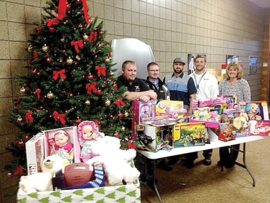 Luther Honda of St. Cloud staff members coupled its Toys for Tots effort with a casino night holiday party.  Employees were given $500 each in funny money if they brought a toy to donate at the event.