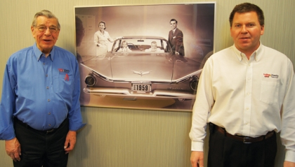 After 61 years selling cars, Floyd Weist, left, still works at the store part-time and his son, Troy, is sales manager.