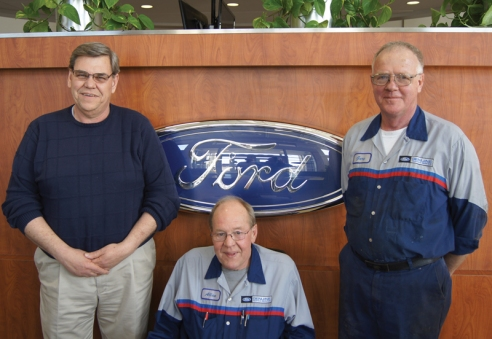 Family Ford parts counterman Tom Nettestad, left, and technicians Allan Wang and Gary Speich have been with the franchise for 44, 40 and 43 years, respectively.  Nettestad  is retiring soon, but Wang and Speich will stay on for a time.