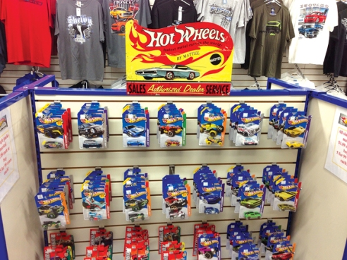 """Single cars and """"Monster Jam Minis"""" are popular, said Parts Manager Tom Kassman.  Pricing is as aggressive as the lowest priced store in the area. """"One customer came in to buy 30 of the single pack cars and was very excited about what he found,"""" he said.  Additionally, a super 6-lane, 8-foot long raceway track was being set up in the children's area of the store."""