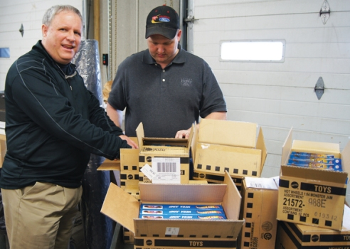 Family Ford GM Joel Bechtold and Ryan Hodgson in shipping and receiving got their hands on the first batch of Hot Wheels cars for sale at the store.  Sales were hot in the first six weeks and more cars are on order.