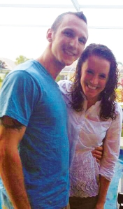Child sponsor Justin Rosckes, left, with his girlfriend, Emily Flavin, who lives in Washington, D.C.