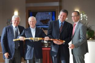 Toyota's vice president of sales Paul Holdridge, left, and Kevin Fletcher, right, GM for Toyota's Chicago Region, present a Samurai sword to President David Luther and store GM Ron Murray. The weapon symbolizes the strength, integrity, loyalty and commitment Toyota has with its dealerships and that of a dealership to its customers.