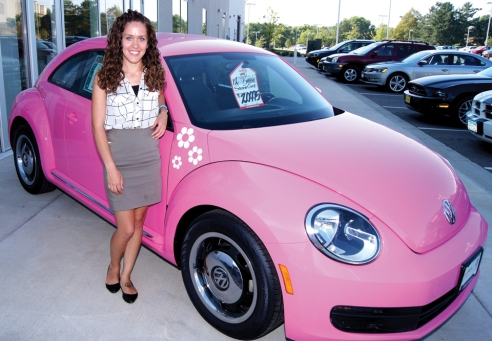 """Covered in pink vinyl wrapping outside, with dash and steering wheel accents, this 2012 VW Beetle prompts people to turn around and come back for photos, explains Trivia Phillips in sales with Burnsville VW.  The store, which once marketed whitewall tires, has two """"Barbie Pink"""" Beetles.  """"We're out of those whitewalls. Now we're in the pink,"""" said Garry Lee Erickson, used car and detail manager."""