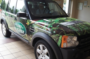 Custom vehicle graphics are applied with artistry and precision, such as this example for Jaguar Land Rover Minneapolis.