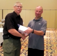 Fargo's Bob Langlie, left, receives the award for Collision and Glass from Director Steve Weisenberger.