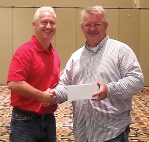 Manager Steve Miller, Brookdale Toyota, is recognized by Service Specialist Tim Stoesz.