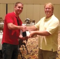 Manager Tom Walsh, left, accepts the award from Parts Specialist Ken Provo for Luther Nissan Kia.