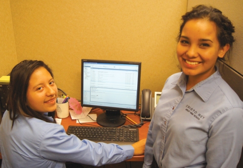 Cristo Rey High School students Ashley Cruz, left and Daniella Mejia are gaining valuable experience at Luther's Home Office.