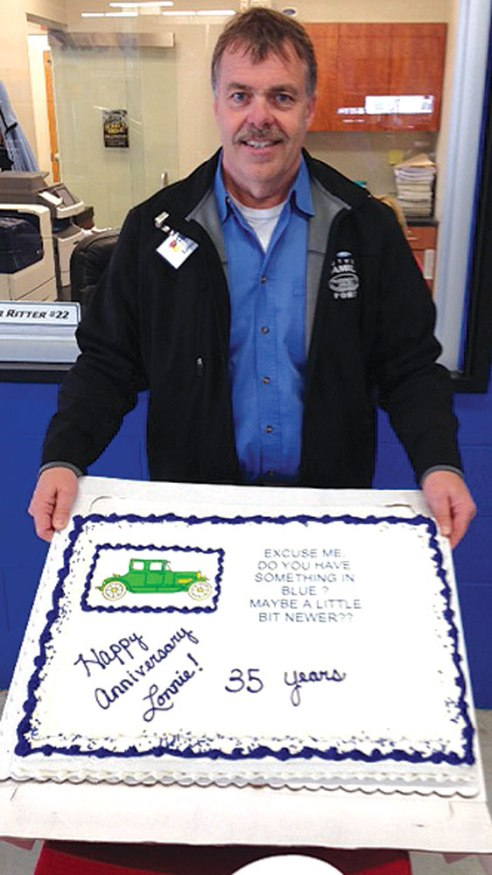 "Celebrating 35 years with the store was Lonnie Hager, shop foreman at Luther Family Ford.  He was once the subject of an ""Ask Lonnie"" billboard campaign."