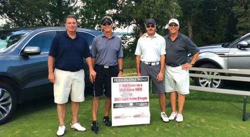 The Gillette Children's Specialty Healthcare Charity Golf Tournament welcomed two Luther GMs and their cars, offered as two-year lease prizes for successful hole in one shots on hole 11 at North Oaks Golf Club.  Bloomington Acura Subaru's Mark Rosenthal is at left, and Ted Terp, with Jaguar Land Rover Minneapolis, at right.