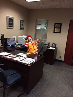 Ronald McDonald puts his feet up and stays a while in the GM's office.