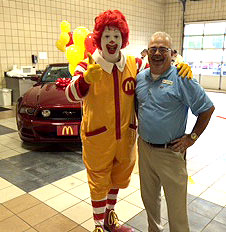 North Country Ford Fleet Manager Tim Angell gets his photo-op with Ronald McDonald.