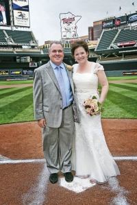 Stacey Rydman (Johnson), Rudy Luther Toyota, married Rob Rydman at Target Field's home plate.
