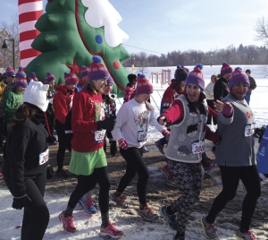 Fatima Moore, above at right, wife of Stephen Moore, (Luther Fiat of Minneapolis) participated in the Ugly Sweater Run in Minneapolis to benefit Save the Children, a child-advocacy nonprofit.