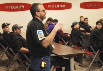 District 287 Automotive Technology Instructor John Preston talks to students about work expectations.