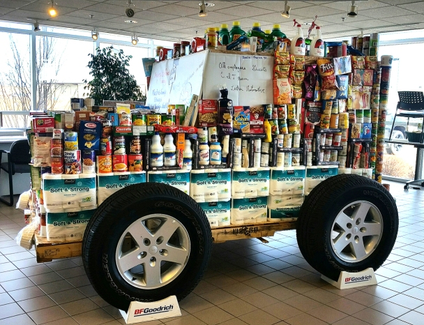 Staff decorated with almost 1,100 pounds of donated items, John Hirsch's Cambridge Motors treated a Jeep display to promote giving.
