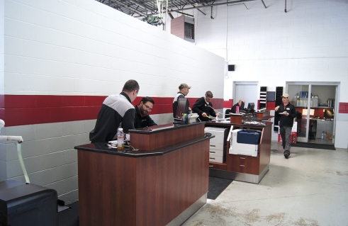 Luther Nissan Kia changed its service drive area, adding a wall behind advisors to bring two new stalls to the busy operation.