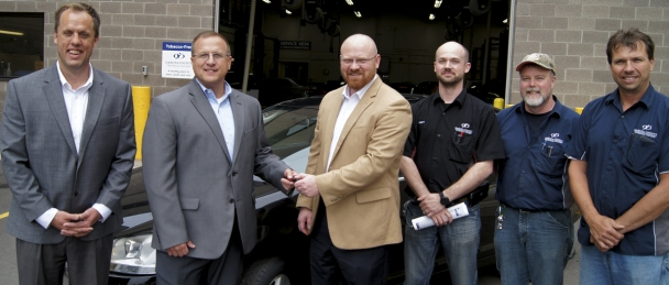 From left are Matt Carlson, Luther Automotive Group; Jeff Fowler, VW of America, DCTC Transportation and Industry Dean Chad Sheets and automotive instructors Matt Boudinot, Jeffrey Copeland and Mark Brantner.