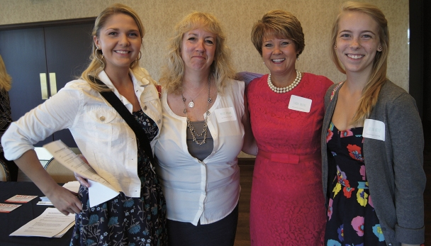 Sales leader Linda Radue, in red, visits with several Luther Auto women open to considering a career in sales.