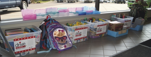 Luther Collision and Glass school supply drive