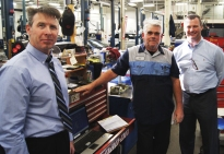 Jim Meehan, center right , at Hopkins Honda was honored by Kevin Barlow, left, American Honda District Parts and Service Manager and GM Kyle Allison.